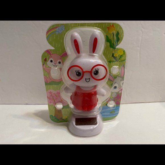 Solar Powered dancing red rabbit w/glasses figuire